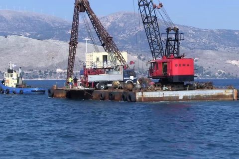 The drilling platform leaves Lixouri harbour for the first borehole location.