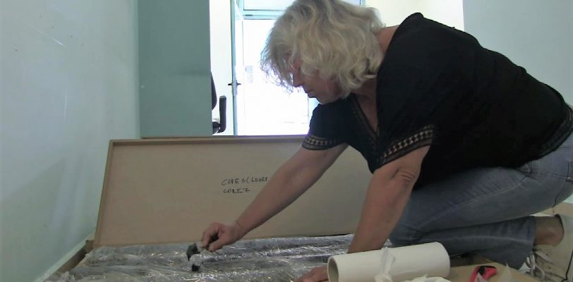 Prof. Maria Triantaphyllou takes an initial sample from one of the cores.