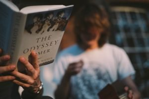 Reading the Odyssey - Photo by Tbel Abuseridze on Unsplash